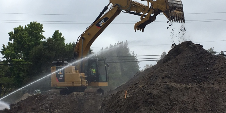 Moving dirt for 500,000-gallon water tank at Pasatiempo Golf Club